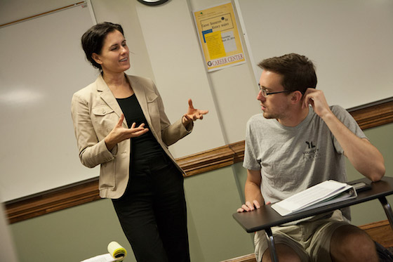 Susan Mattern talks with a student in her class