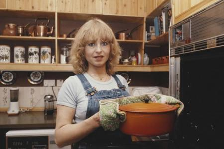 Photo: Bloomberg Opinion online image of woman holding a casserole dish